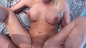 She is sliding her trimmed twat on the amazing long weiner