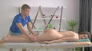 Juvenile masseur is getting a hard boner from massaging playgirl