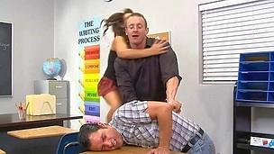 Excited teacher copulates a cute schoolgirl in the classroom
